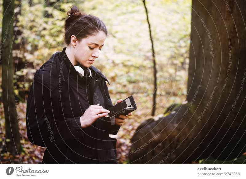 young woman uses smartphone in forest Lifestyle Leisure and hobbies Cellphone PDA Internet Human being Feminine Young woman Youth (Young adults) Woman Adults 1