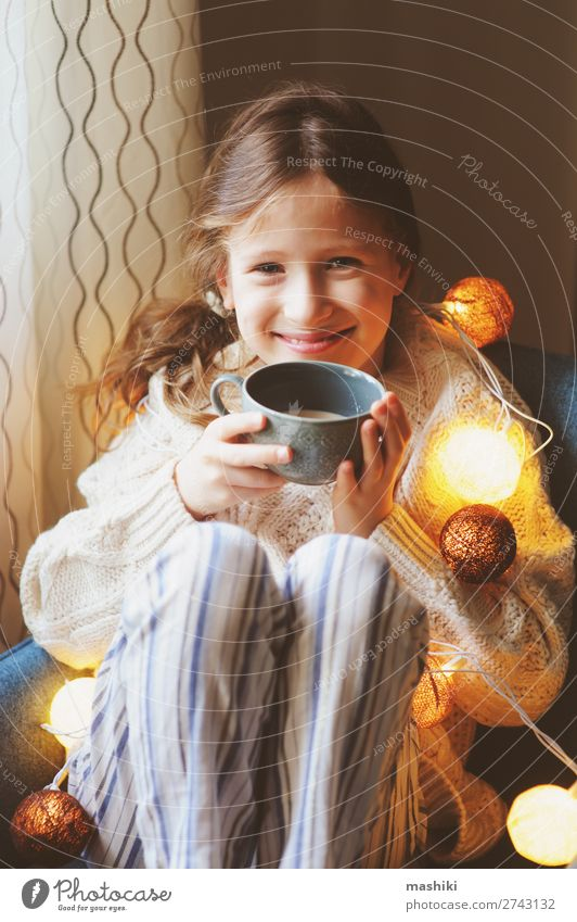 kid girl drinking hot cocoa at home in winter Drinking Tea Life Relaxation Winter House (Residential Structure) Decoration Chair Feasts & Celebrations