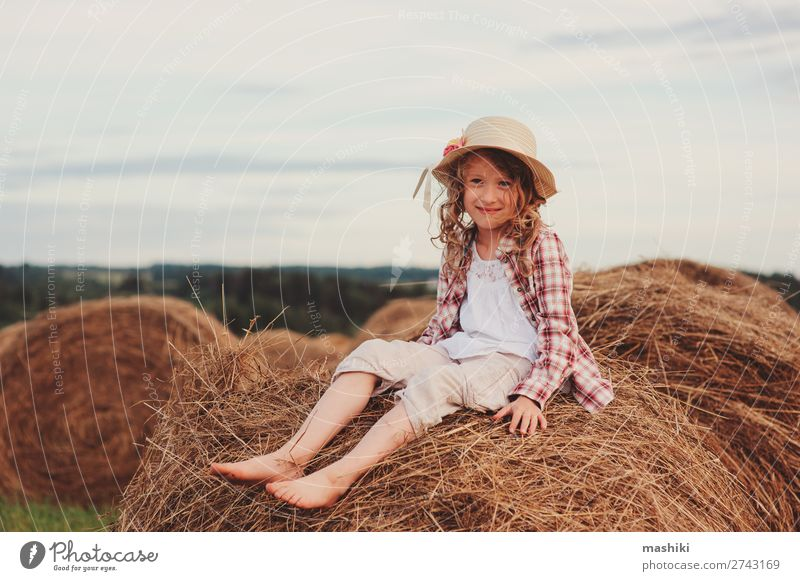 happy child girl in country style plaid shirt Style Joy Relaxation Vacation & Travel Summer Child Infancy Nature Landscape Meadow Shirt Hat Smiling Happiness