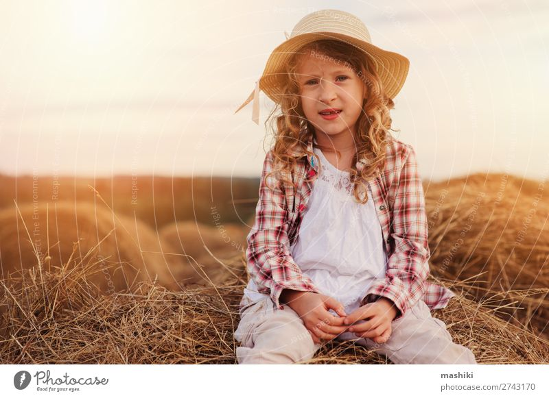 happy child girl in country style plaid shirt and hat Style Joy Relaxation Vacation & Travel Summer Child Infancy Nature Landscape Meadow Shirt Hat Smiling