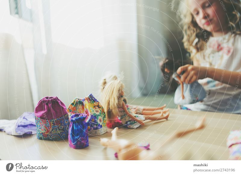kid girl playing with dolls at home Lifestyle Joy Happy Leisure and hobbies Playing Child School Infancy Skirt Dress Cloth Toys Doll Funny Natural Clean Home