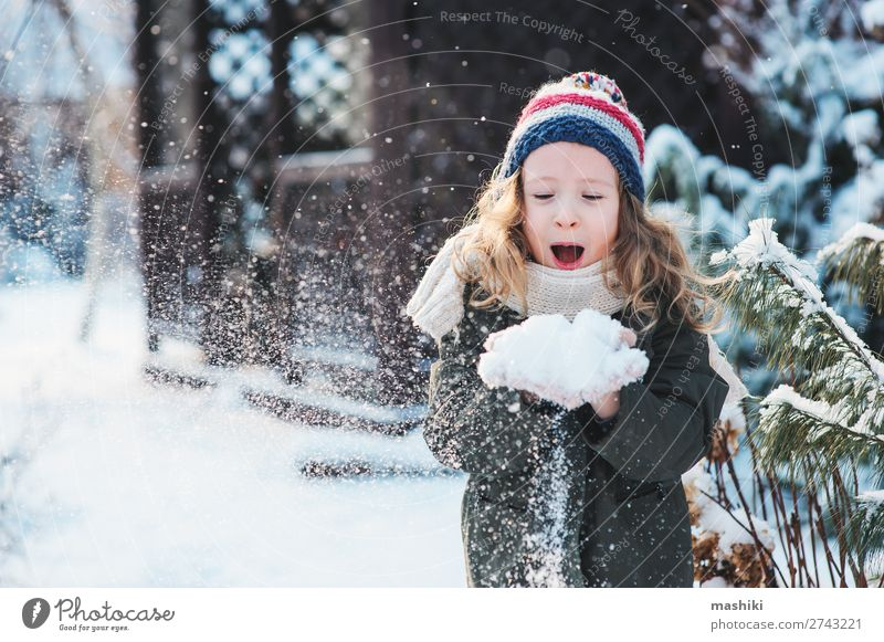 happy child girl playing with snow Joy Happy Playing Knit Vacation & Travel Winter Snow Garden Child Weather Forest Scarf Hat Drop Smiling Laughter White kid