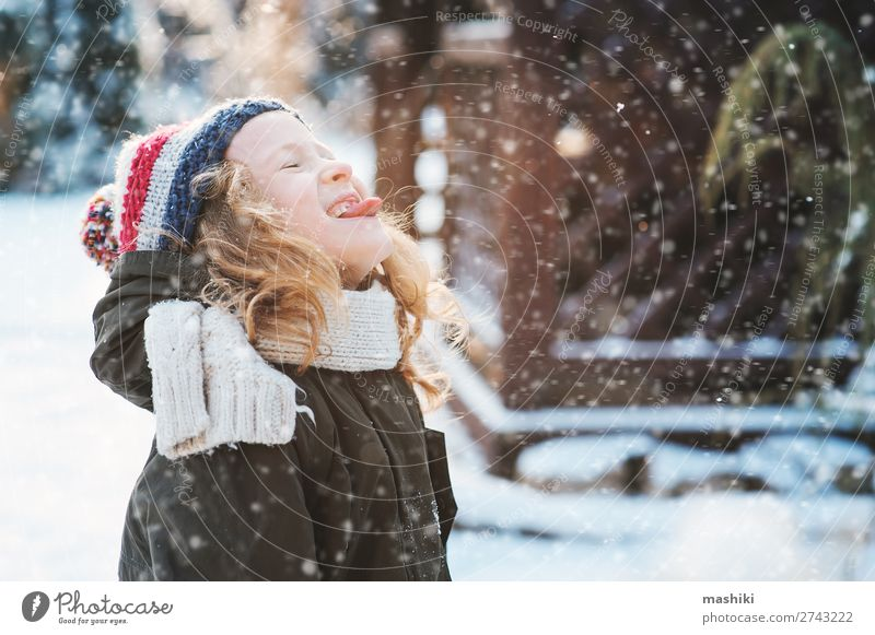 happy child girl catching snowflakes and playing Joy Happy Playing Knit Vacation & Travel Winter Snow Garden Child Weather Forest Scarf Hat Drop Smiling