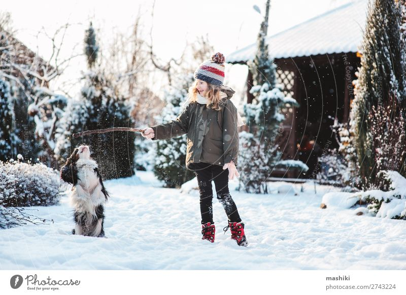 happy child playing with dog in winter Joy Happy Playing Knit Vacation & Travel Winter Snow Garden Child Animal Weather Forest Scarf Hat Pet Dog Drop Smiling