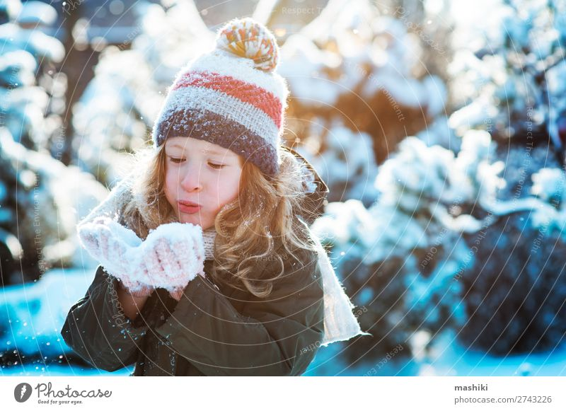 child girl playing with snow in winter garden or forest Joy Happy Playing Knit Vacation & Travel Winter Snow Garden Child Weather Forest Scarf Hat Drop Smiling