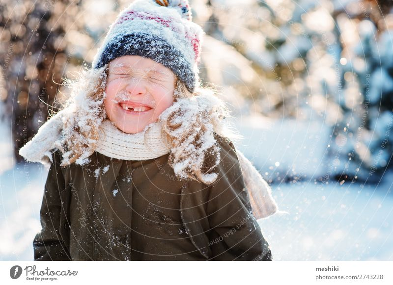close up winter portrait of happy kid girl Child Vacation & Travel White Joy Forest Winter Snow Laughter Happy Garden Playing Weather Smiling Action Drop Hat