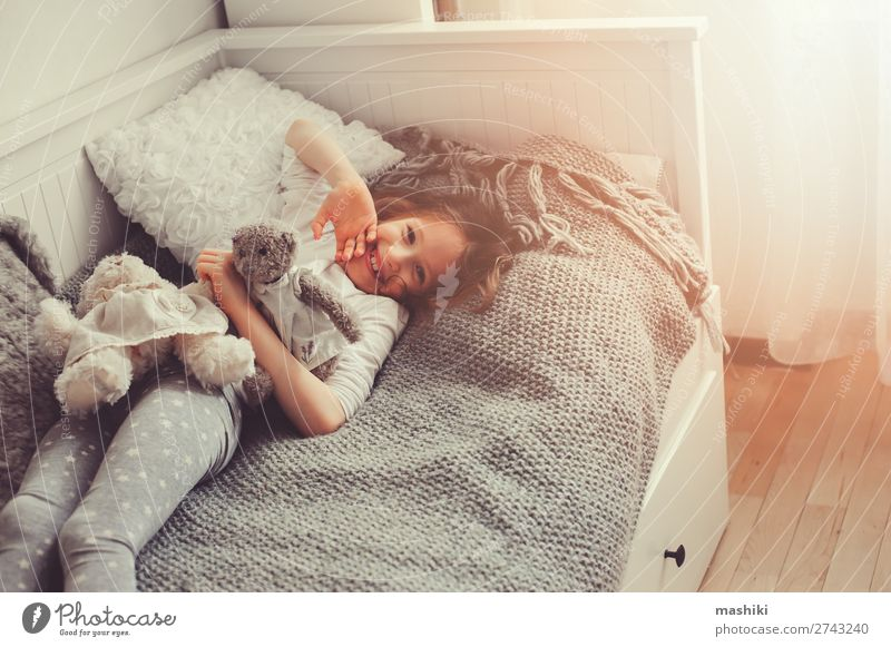 happy kid girl walking up in early morning in her room Lifestyle Joy Happy Relaxation Playing Bedroom Child Friendship Infancy Toys Teddy bear Smiling Laughter