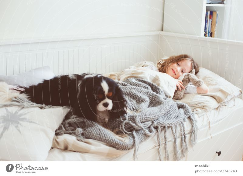 happy kid girl waking up in the morning Lifestyle Joy Happy Relaxation Playing Bedroom Child Friendship Infancy Pet Dog Smiling Laughter Sleep Modern White Home