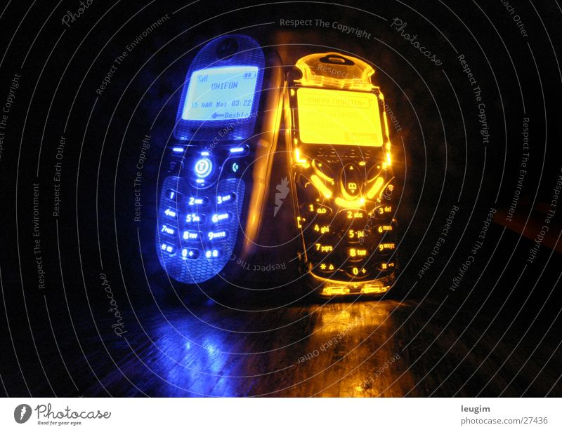 The pair Cellphone Entertainment electronics Telecommunications Together Bright Blue Yellow Esthetic Contentment Relationship Design Energy Communicate Contact
