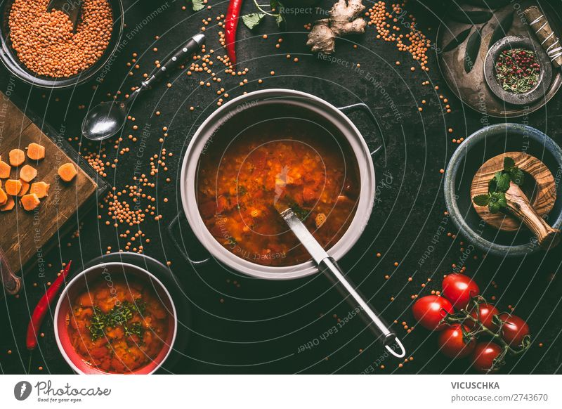 Red lentil soup in a saucepan Food Grain Soup Stew Nutrition Lunch Banquet Organic produce Vegetarian diet Diet Crockery Plate Pot Design Healthy Eating Table