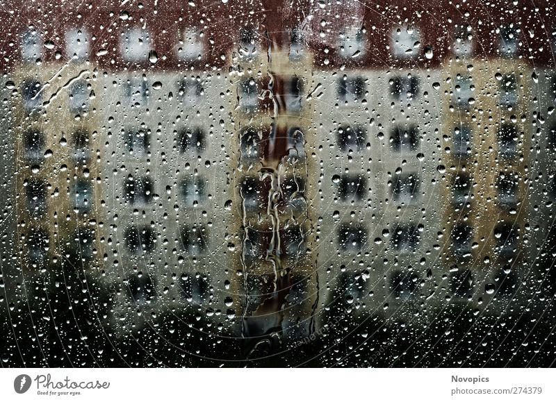 a rainy day Nature Water Drops of water Weather Storm Architecture Cold Wet Gloomy Yellow Red urban Prefab construction Häuserblock Rain structure colored