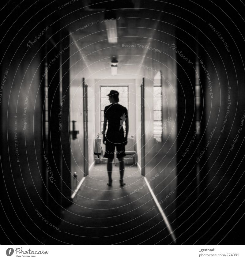shadowy existence. Human being Masculine Young man Youth (Young adults) Man Adults Body 1 18 - 30 years Shorts Baseball cap Silhouette Dark Hallway Brick