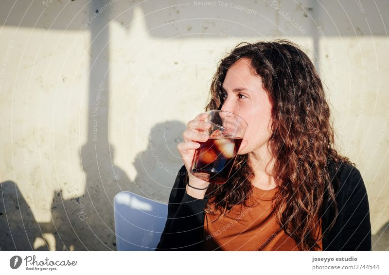 Woman having a drink on a terrace in the sun Alcoholic drinks Lifestyle Joy Happy Beautiful Face Leisure and hobbies Vacation & Travel Summer Sun Table