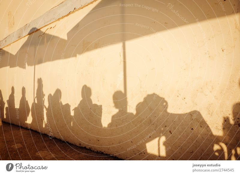 Shadows of people on the terrace of a bar Happy Summer Sun Human being Woman Adults Man Friendship Group Art Rock Building Terrace Street To enjoy Happiness