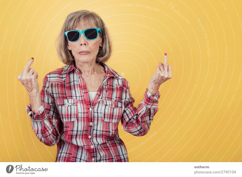 Portrait of senior woman with sunglasses insulting with finger Lifestyle Retirement Human being Feminine Female senior Woman Grandmother 1 60 years and older