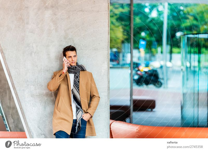 Young man wearing denim clothes using a mobile phone Lifestyle Elegant Style Beautiful Hair and hairstyles To talk Telephone PDA Human being Masculine