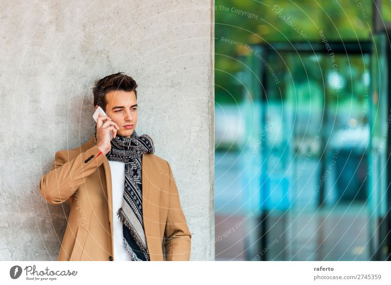 Young man wearing denim clothes using a mobile phone Lifestyle Elegant Style Beautiful Hair and hairstyles To talk Telephone PDA Masculine Youth (Young adults)