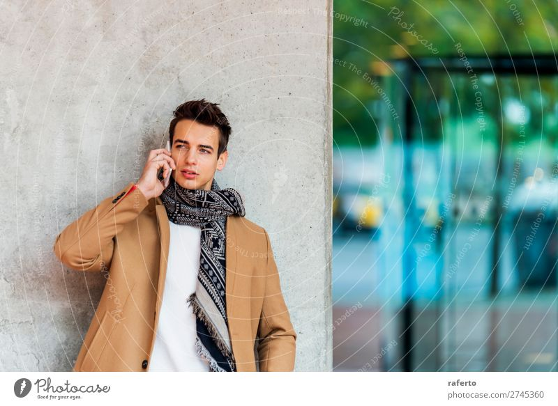 Young man wearing denim clothes using a mobile phone Lifestyle Elegant Style Beautiful Hair and hairstyles To talk Telephone PDA Human being