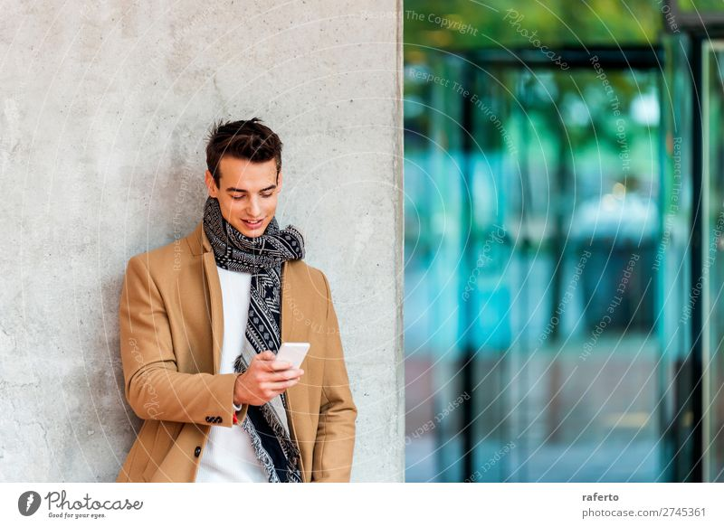 Young man wearing denim clothes using a mobile phone Lifestyle Elegant Style Beautiful Hair and hairstyles Telephone PDA Human being Masculine