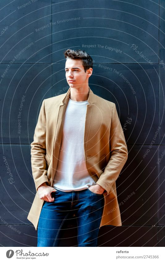 Fashionable young man standing against black wall Elegant Style Beautiful Hair and hairstyles Human being Masculine Young man Youth (Young adults) Man Adults 1