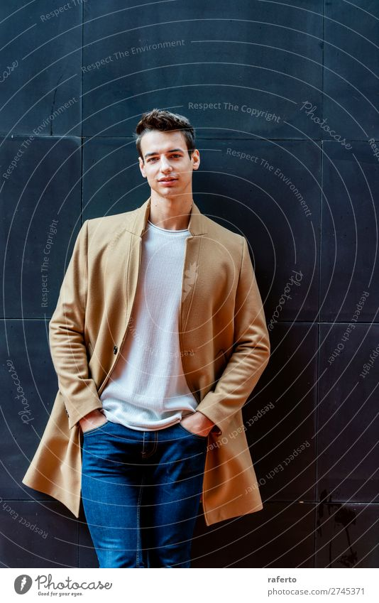 Fashionable young man standing against black wall Elegant Style Beautiful Hair and hairstyles Human being Masculine Young man Youth (Young adults) Man Adults
