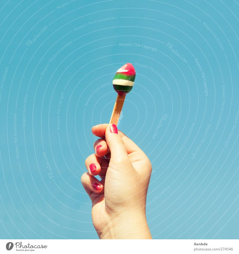 like ice in the sunshine Human being Hand Fingers Cold Fingernail Sunlight Ice cream Melt Torch Green Red Blue Summer Ice cream in style Colour photo