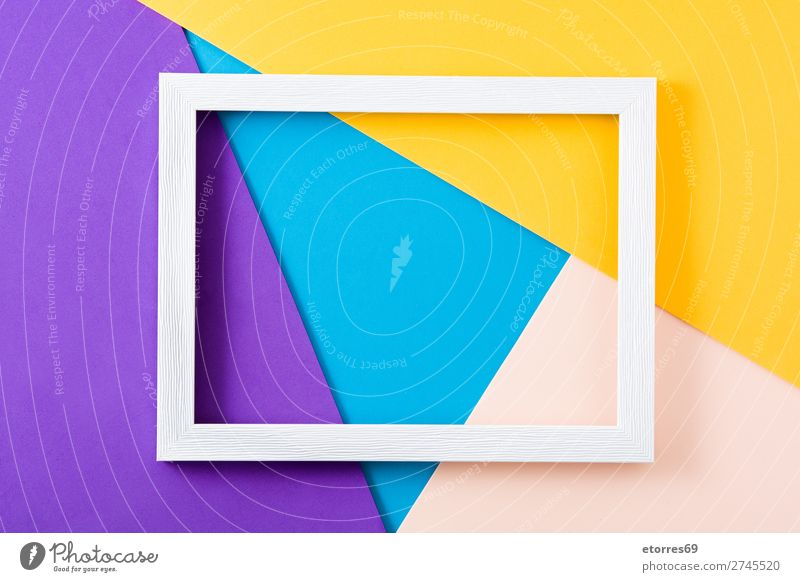 White wooden frame on colorful background. Frame Mock-up Wood Colour Multicoloured Neutral Background Copy Space Yellow Purple Blue Easter Abstract Empty