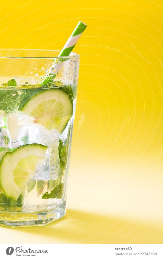 Mojito cocktail in glass on yellow background Cocktail Beverage Drinking Alcoholic drinks Refreshment Summer Lime Green Mint Juice Rum Cold Ice Mixer Fruit