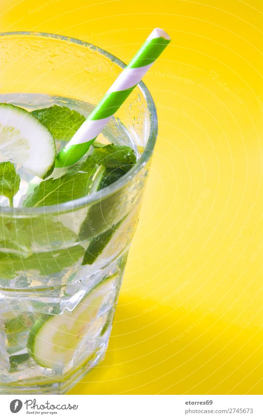 Mojito cocktail in glass on yellow background Cocktail Beverage Drinking Alcoholic drinks Refreshment Summer Lime Green Mint Juice Rum Cold Ice Ice cream Mixer