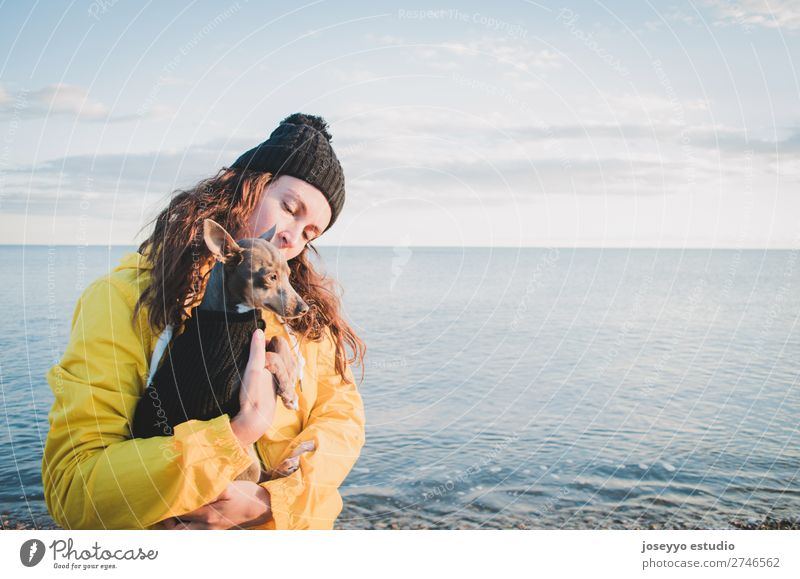 Woman with her little dog on the beach Lifestyle Relaxation Trip Freedom Sun Beach Winter Friendship 30 - 45 years Adults Nature Animal Horizon Coast Jacket