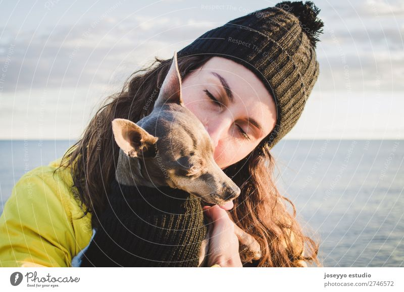woman with her little dog on the beach Nature Dog Relaxation Animal Winter Beach Lifestyle Adults Yellow Love Coast Freedom Friendship Trip Horizon Pet