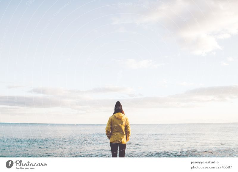 Woman on the beach looking at the horizon Nature Sun Relaxation Winter Beach Lifestyle Adults Yellow Sports Coast Copy Space Freedom Fashion Trip Horizon