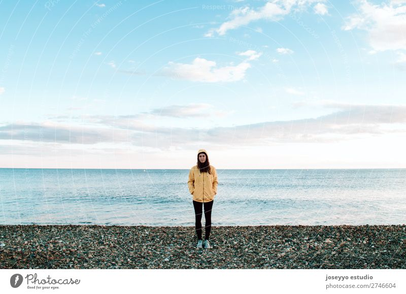 Woman on the beach in winter Nature Sun Relaxation Winter Beach Lifestyle Adults Yellow Sports Coast Copy Space Freedom Fashion Trip Horizon