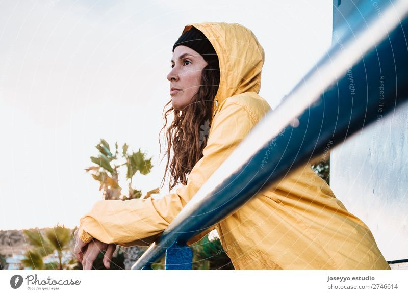 Young brunette woman on a lifeguard tower Lifestyle Relaxation Trip Freedom Sun Beach Winter Sports 30 - 45 years Adults Nature Horizon Coast Places Fashion