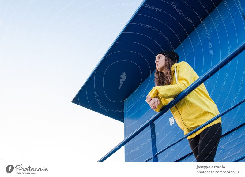 young brunette woman on a lifeguard tower Nature Sun Relaxation Winter Beach Lifestyle Adults Yellow Sports Coast Copy Space Freedom Fashion Trip Horizon