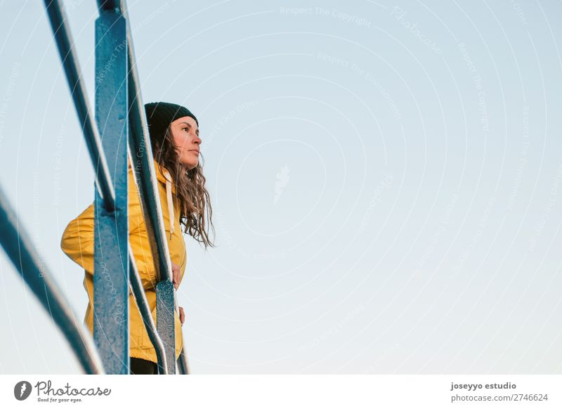 brunette woman on a lifeguard tower Nature Sun Relaxation Winter Beach Lifestyle Adults Yellow Sports Coast Copy Space Freedom Fashion Trip Horizon
