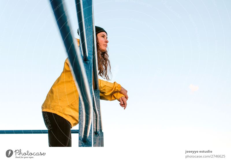 Brunette woman on a lifeguard tower Nature Sun Ocean Relaxation Winter Beach Lifestyle Adults Yellow Sports Coast Copy Space Freedom Fashion Trip