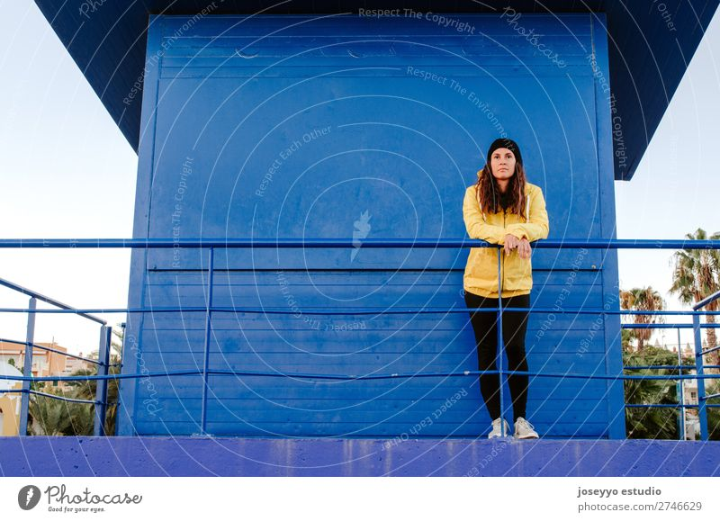 woman on a lifeguard tower Nature Sun Relaxation Winter Beach Lifestyle Adults Yellow Sports Coast Copy Space Freedom Fashion Trip Horizon