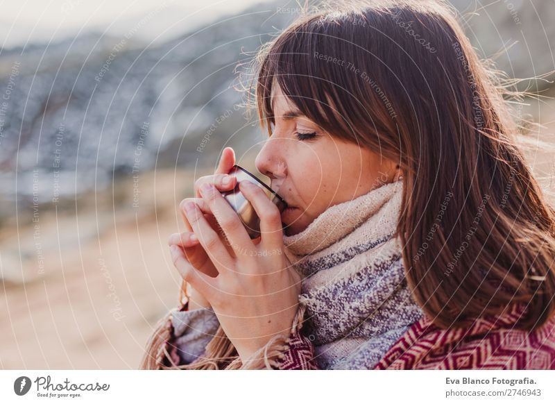 young woman in mountain drinking hot beverage Beverage Drinking Hot drink Hot Chocolate Coffee Tea Lifestyle Beautiful Face Relaxation Leisure and hobbies