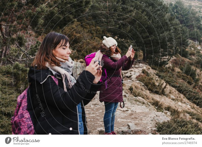 two successful hiker woman friends on mountain peak Beautiful Vacation & Travel Adventure Freedom Snow Mountain Hiking Success Cellphone Woman Adults Friendship