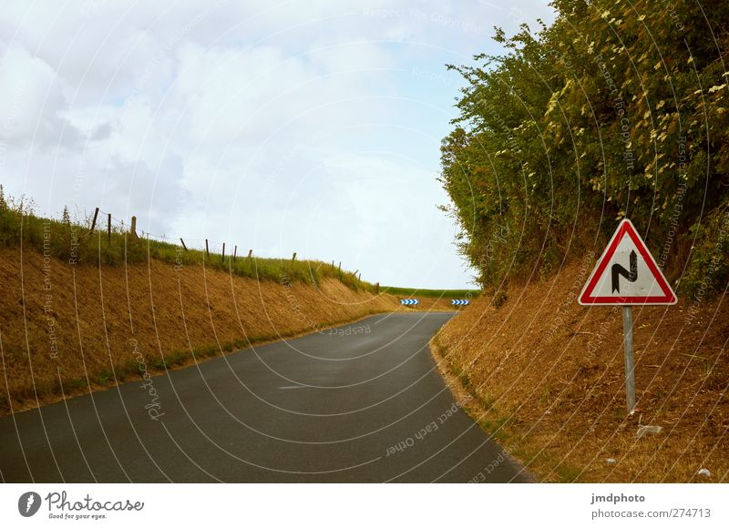 Attention S curve Environment Sky Clouds Summer Beautiful weather Field Transport Traffic infrastructure Road traffic Motoring Street Road sign Curve