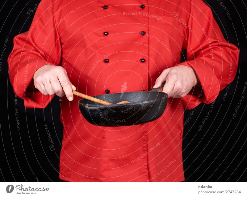 cook holding an empty black frying pan Pan Spoon Kitchen Restaurant Profession Cook Human being Man Adults Hand Clothing Red Black Cast iron Caucasian chef