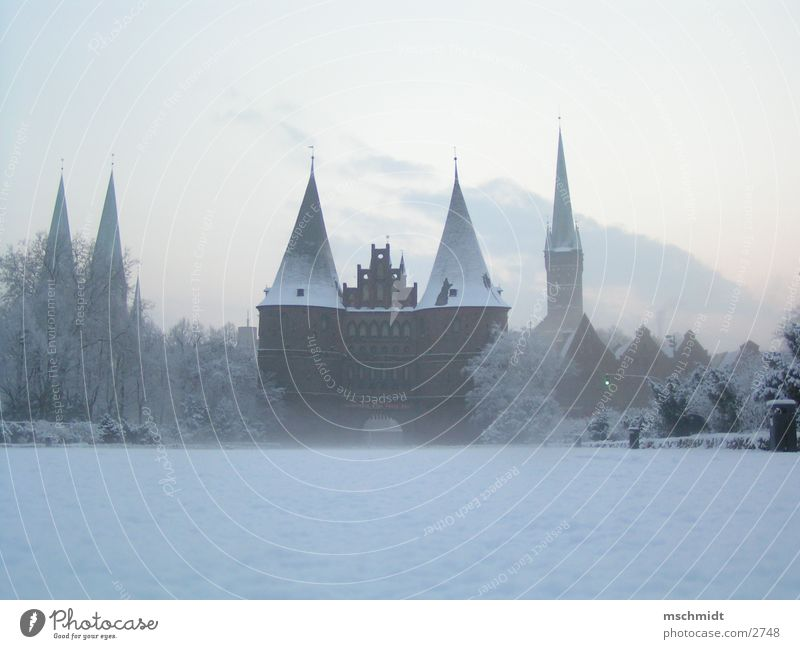 Lübeck in winter Hanseatic League Winter Historic holstentor Snow Landmark Tourist Attraction Historic Buildings Famous building Famousness Copy Space bottom