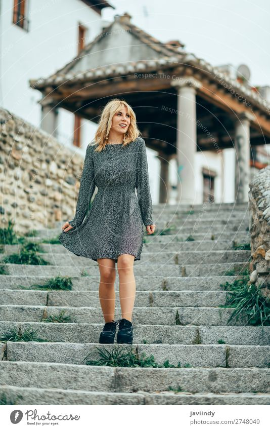 Happy young blond woman standing on urban background. Lifestyle Style Joy Beautiful Hair and hairstyles Human being Feminine Young woman Youth (Young adults)