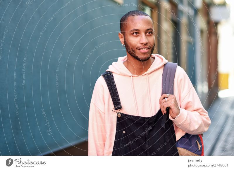 Young black man walking smiling down the street. Lifestyle Happy Beautiful Human being Man Adults Street Fashion Clothing Shirt Sweater Beard Smiling Stand