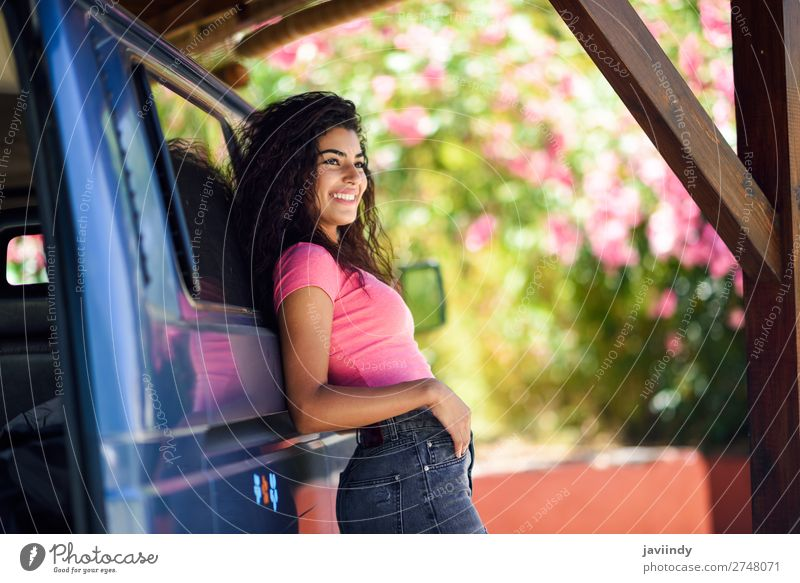 Young woman in a camper van with pink flowers Woman Human being Vacation & Travel Nature Youth (Young adults) Summer Beautiful Green Flower Joy Black