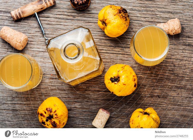 Wine from quince wine drink fruit alcohol glass fresh table beverage liquor liquid yellow bottle autumn seasonal liqueur corkscrew wine corkscrew vodka carafe