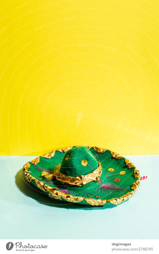 Mexican sombrero hat on geometric yellow and green pastel tones Design Summer Culture Fashion Hat Tradition Sombrero Mexicans background Mexico party fiesta