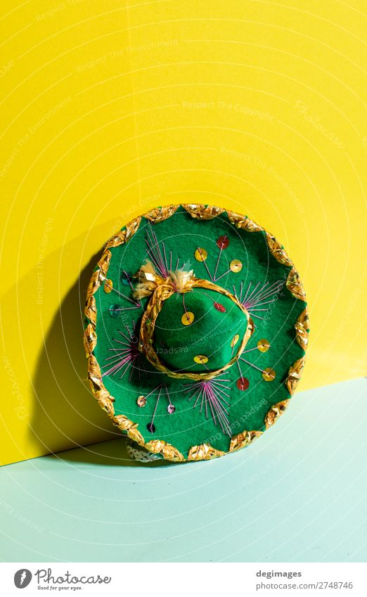 Mexican sombrero hat on geometric yellow and green pastel Design Summer Culture Fashion Hat Tradition Sombrero Mexicans background Mexico party fiesta mariachi