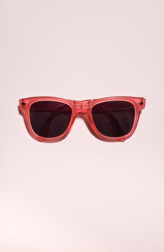 Red bright sunglasses on a pastel pink background. Summer time Style Design Vacation & Travel Sun Beach Art Fashion Accessory Sunglasses Plastic Bright